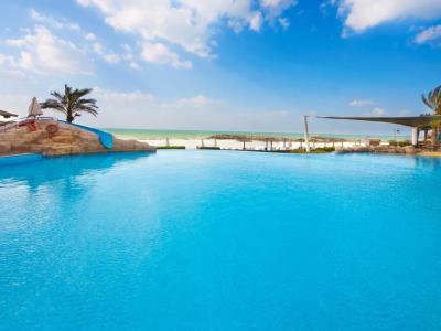 outdoor pool 1 - hotel coral beach resort sharjah - sharjah, united arab emirates
