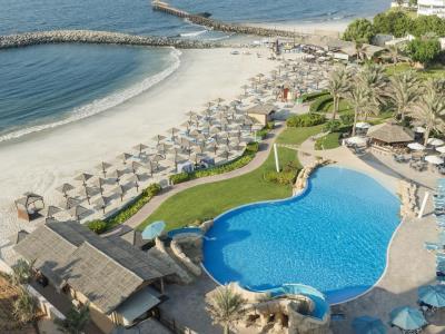 outdoor pool - hotel coral beach resort sharjah - sharjah, united arab emirates