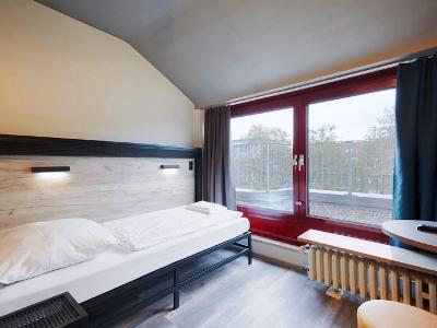 bedroom 2 - hotel a and o dusseldorf hauptbahnhof - dusseldorf, germany