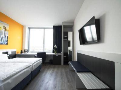 bedroom 2 - hotel carathotel dusseldorf city - dusseldorf, germany