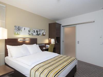 bedroom - hotel holiday inn munich unterhaching - unterhaching, germany