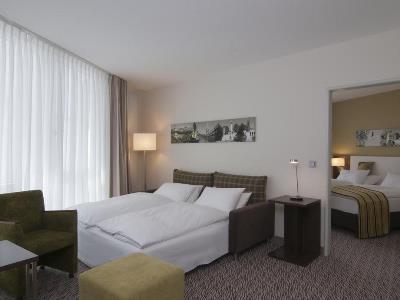 bedroom 2 - hotel holiday inn munich unterhaching - unterhaching, germany