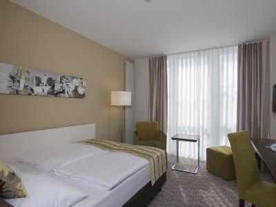 bedroom 3 - hotel holiday inn munich unterhaching - unterhaching, germany