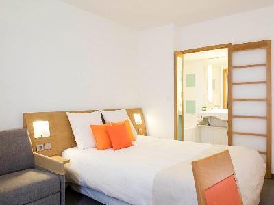 bedroom - hotel novotel reims tinqueux - reims, france