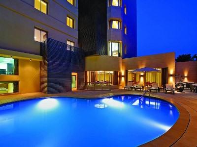 outdoor pool - hotel corp amman - amman, jordan