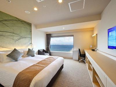 bedroom - hotel oriental suites airport osaka rinku - izumisano, japan