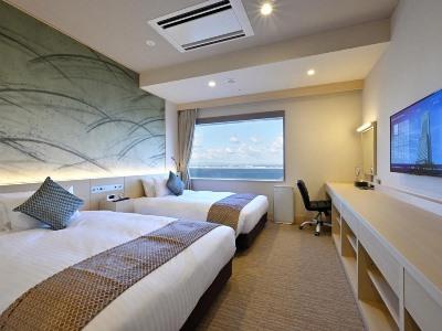 bedroom 1 - hotel oriental suites airport osaka rinku - izumisano, japan
