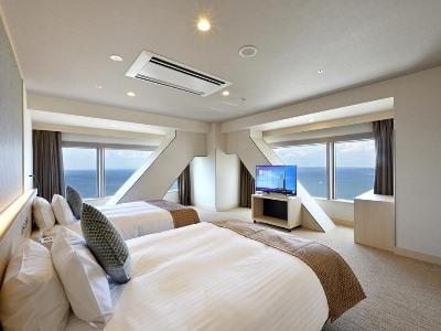 bedroom 2 - hotel oriental suites airport osaka rinku - izumisano, japan