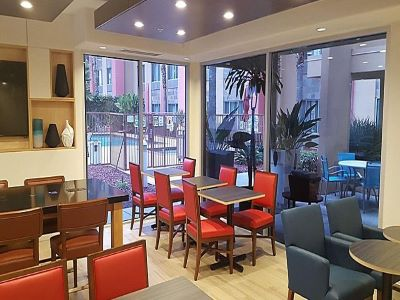 breakfast room - hotel holiday inn exp suites milpitas central - fremont, california, united states of america