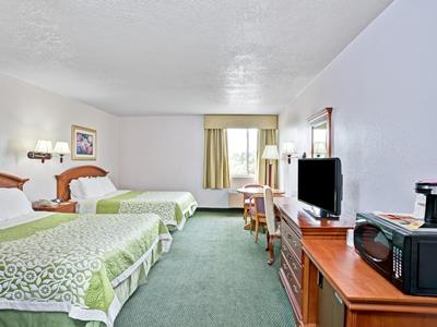 bedroom 1 - hotel days inn and suites by wyndham fullerton - fullerton, united states of america