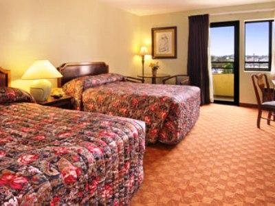 bedroom - hotel ramada plaza garden grove - garden grove, united states of america