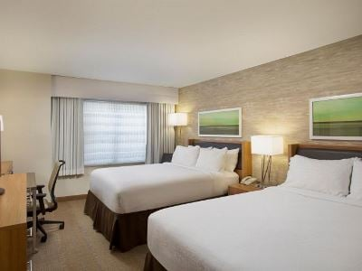 bedroom 1 - hotel holiday inn grand rapids airport - kentwood, united states of america